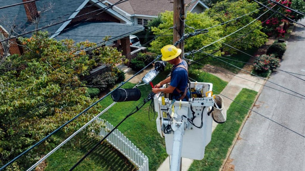 A licensed electrician fixing a power line