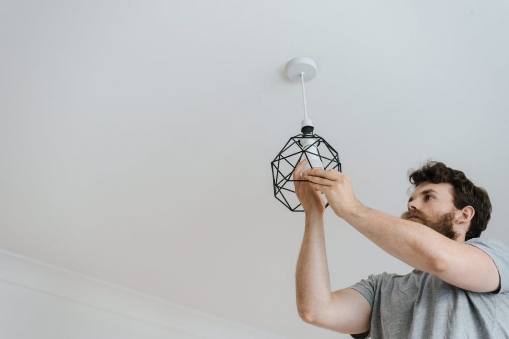 A remote worker installing new lighting