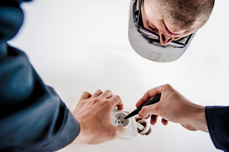 An electrician fixing a tripped circuit.