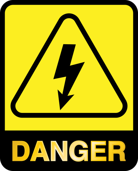 A danger sign with a black arrow and yellow background