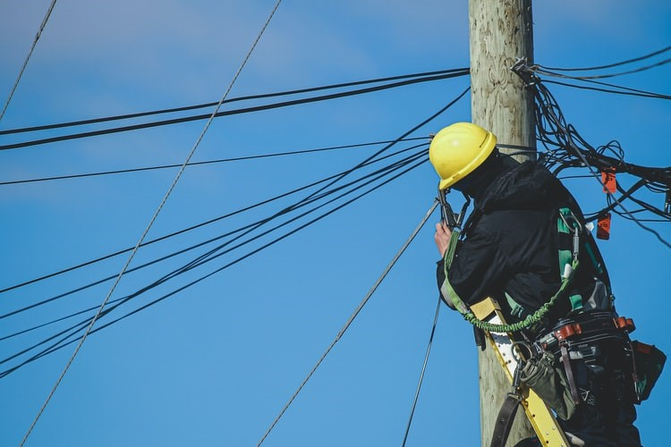 An electrician performing rewiring services in Philadelphia