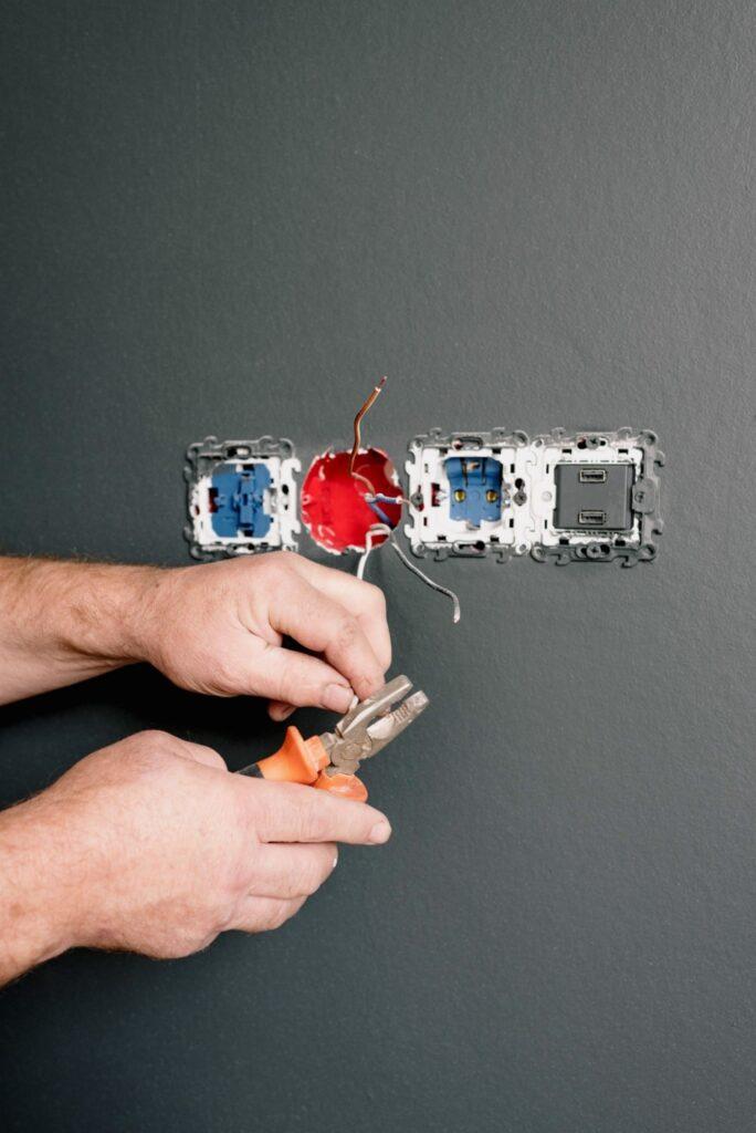 Electrician working on socket