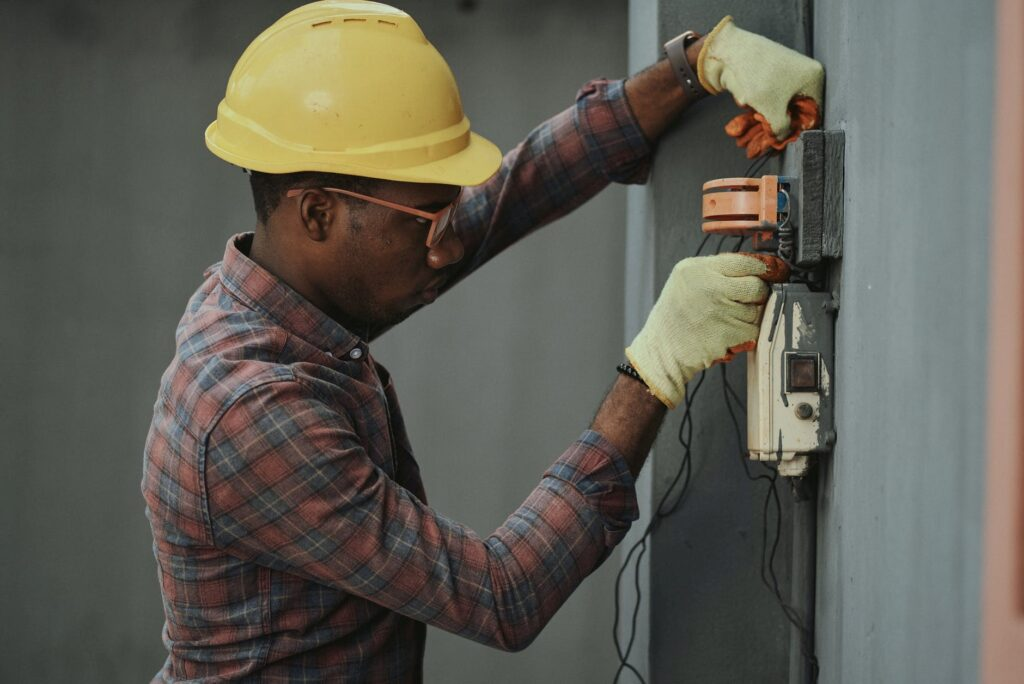An electrician fixing an electrical issue